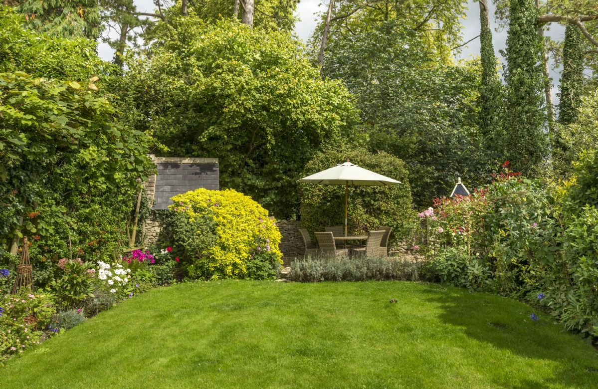 The well established garden is full of beautiful plants and flowers