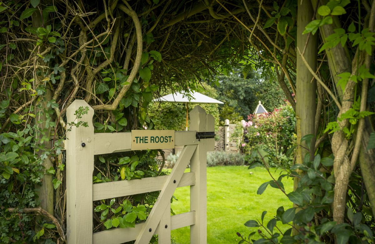Along a pathway behind the house is a beautiful, fully enclosed garden