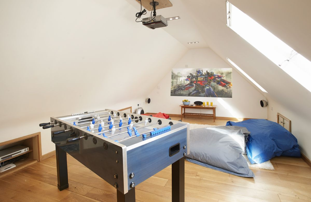 Cinema room with  projector, table tennis and table football