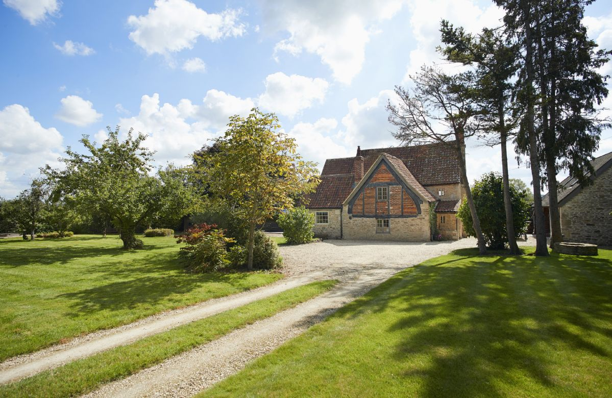 Redbridge Cottage sits within a large enclosed garden.
