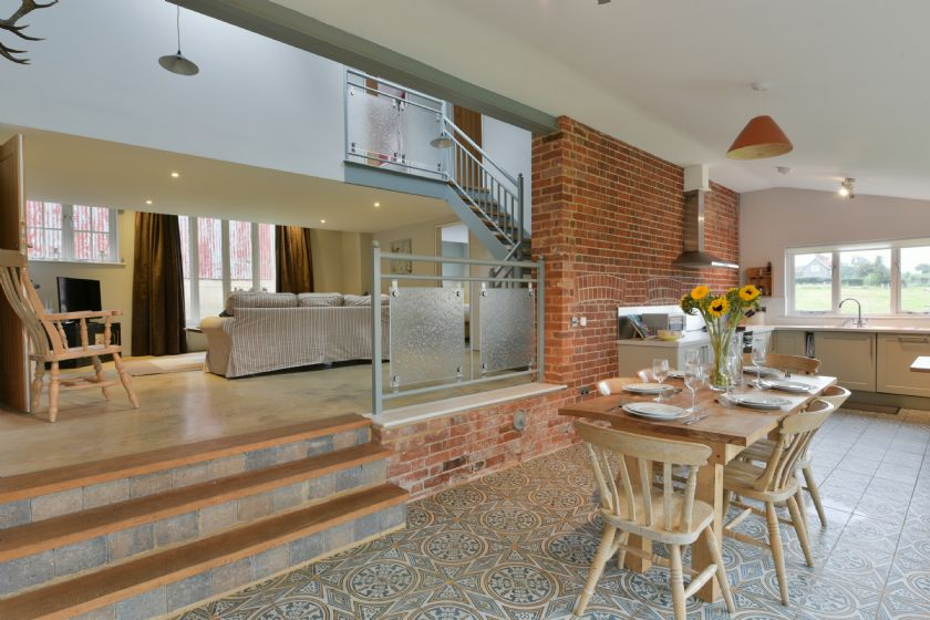 The Dairy: split level ground floor with op-en plan kitchen/dining area and table and chairs