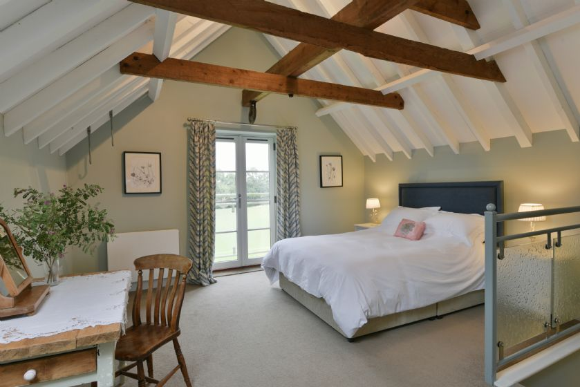 The parloour: First floor open blan bedroom with 5' king size bed and en-suite bathroom area