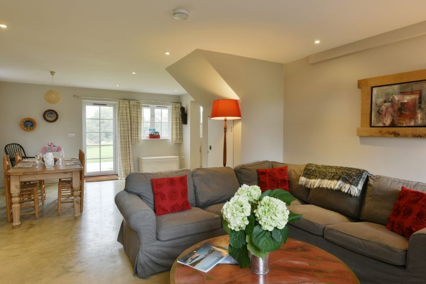 The Parlour: Ground floor with kitchen and sitting room/dining room with table chairs