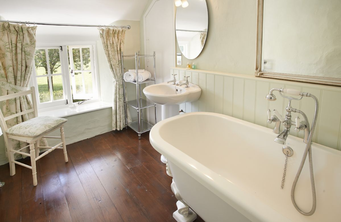 First floor: Bathroom with a free-standing roll top bath, separate wc and basin