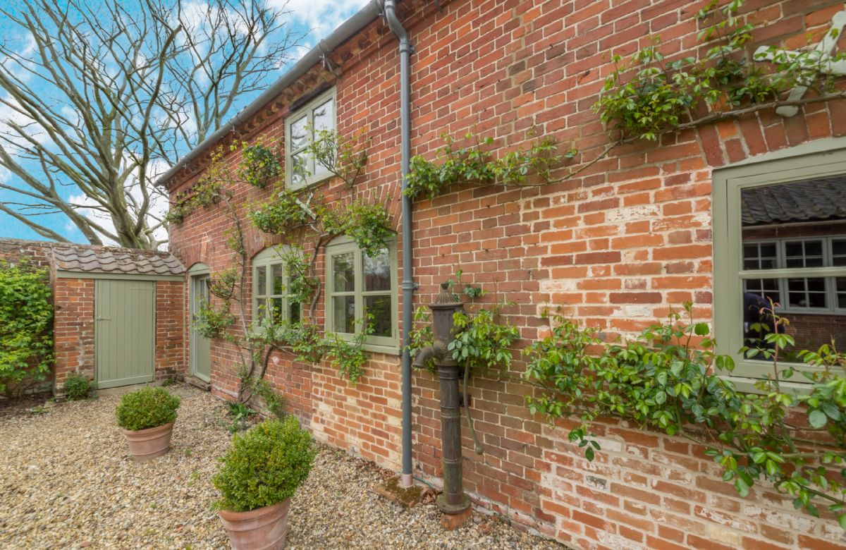 Stockman's Cottage has plenty of off-road parking space and a delightful cottage style garden