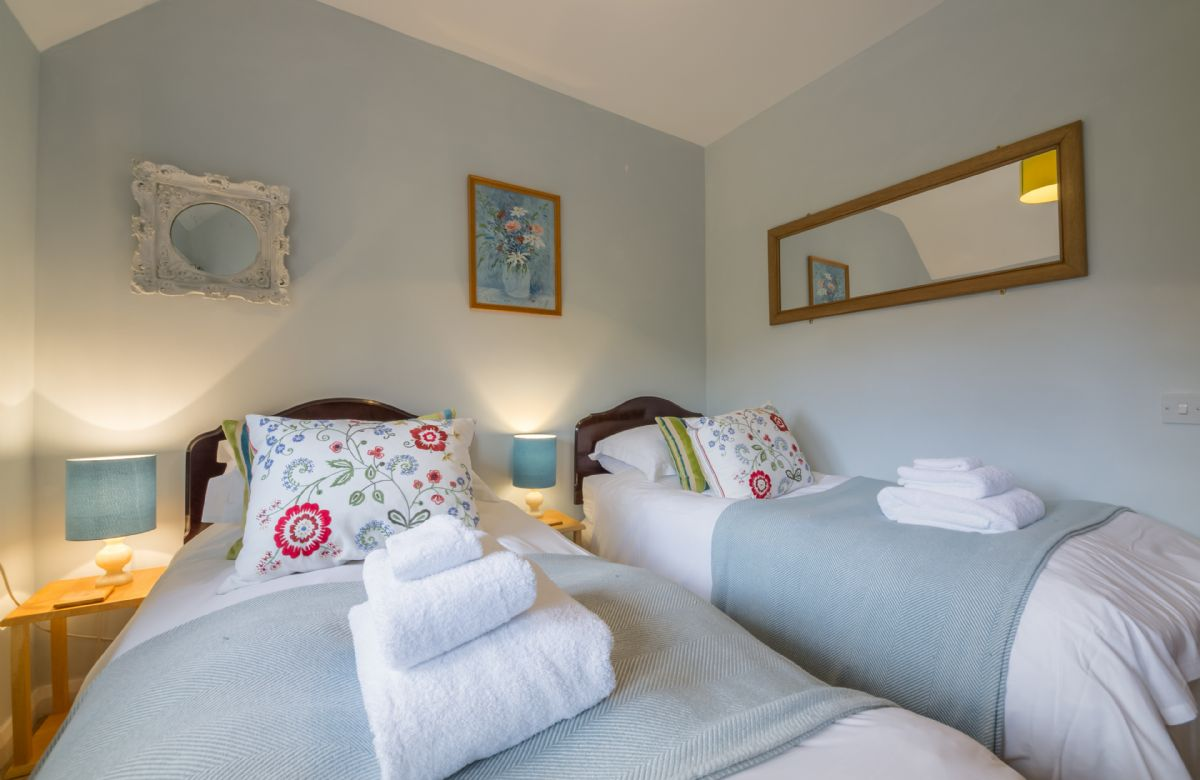 First floor: Small twin bedroom with 3' beds in House