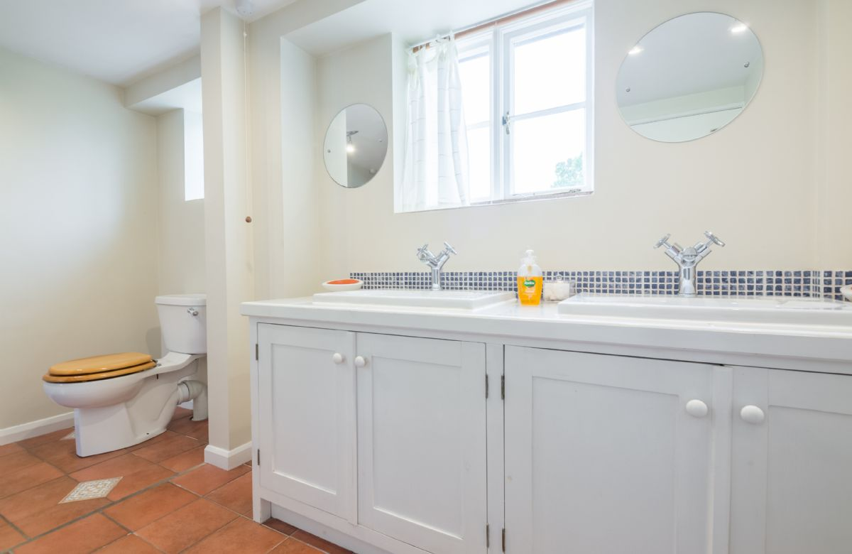 Ground floor: Bathroom with a twin sink unit in House
