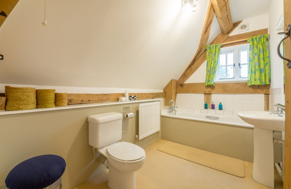 First floor: Bathroom with shower attachment in Cottage