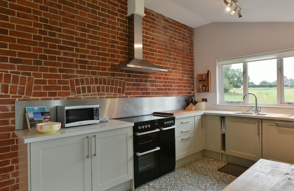 The Dairy: Split level ground floor with open plan kitchen/dining area and table and chairs