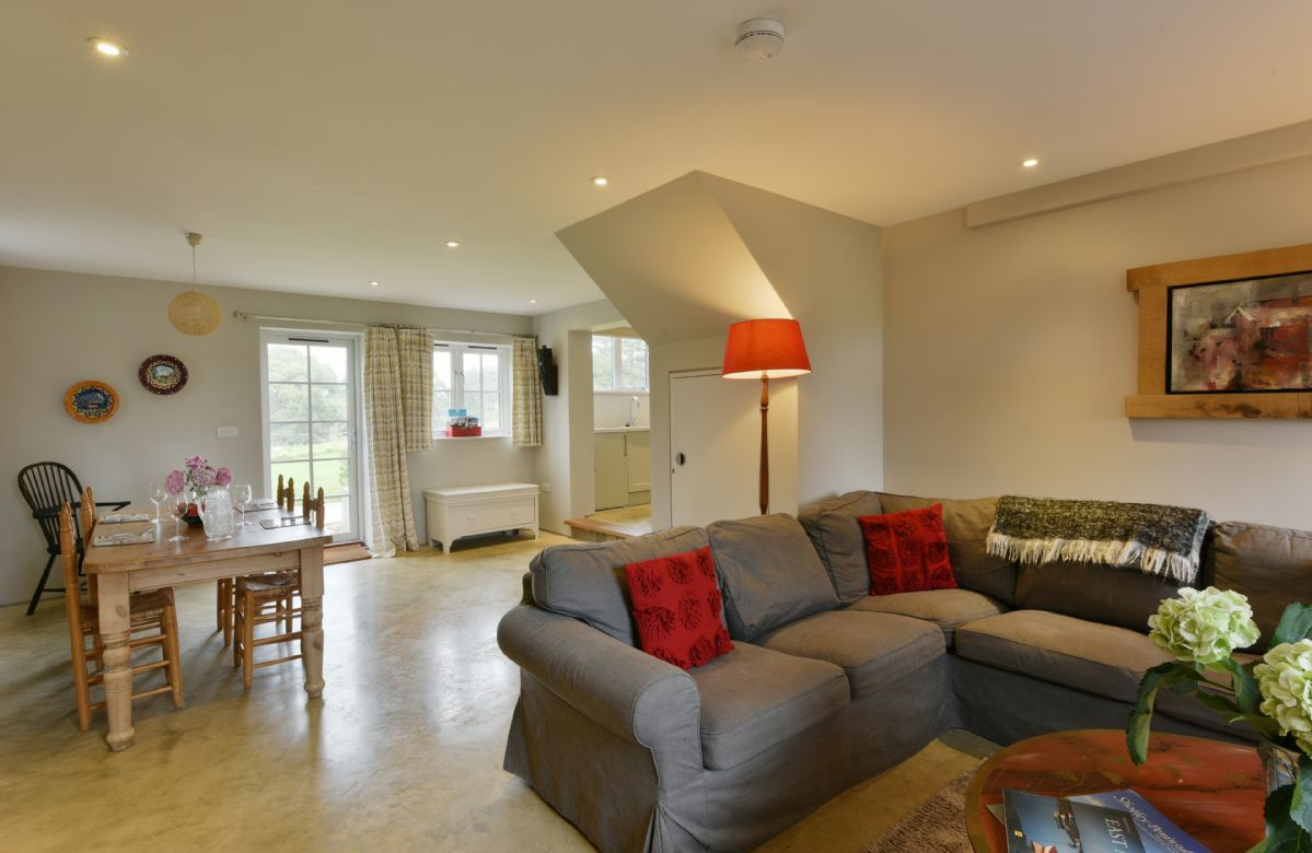 The Parlour: Ground floor with kitchen and sitting room/dining room with table and chairs