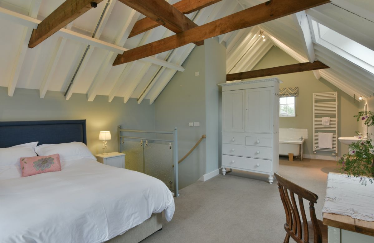 The Parlour:  First floor open plan bedroom with 5' king size bed and en-suite bathroom area