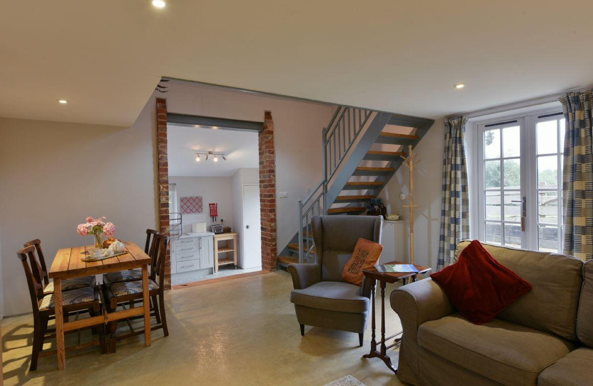 The Buttery: Ground floor with kitchen and sitting room/dining room with table and chairs