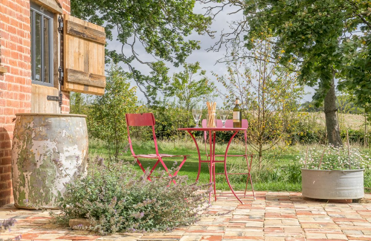 Patio with table and chairs for two