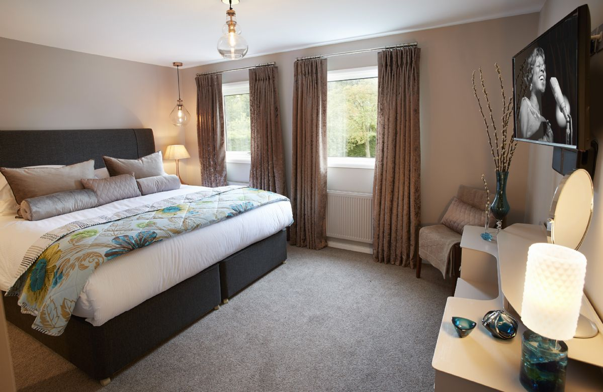 First floor: Bedroom four has a 6' super-king bed and views to the orchard