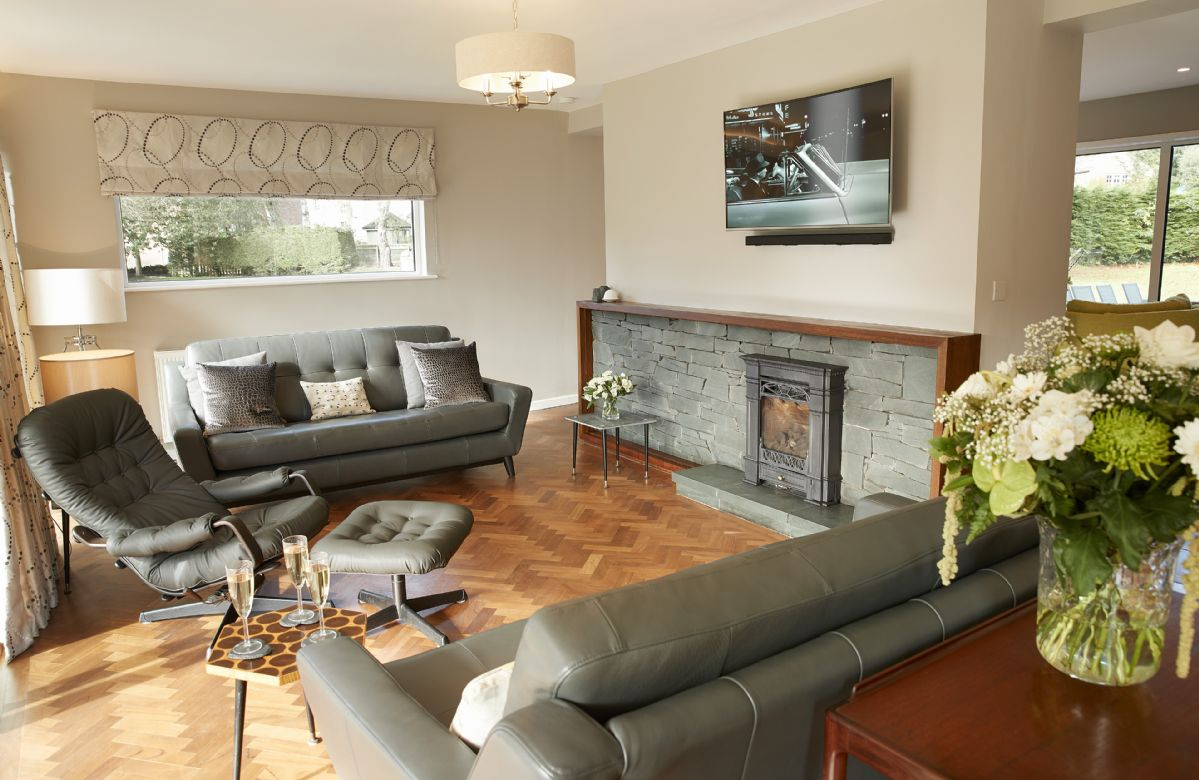 Ground floor: Sitting room with double sliding doors to covered patio with views to the River Eden