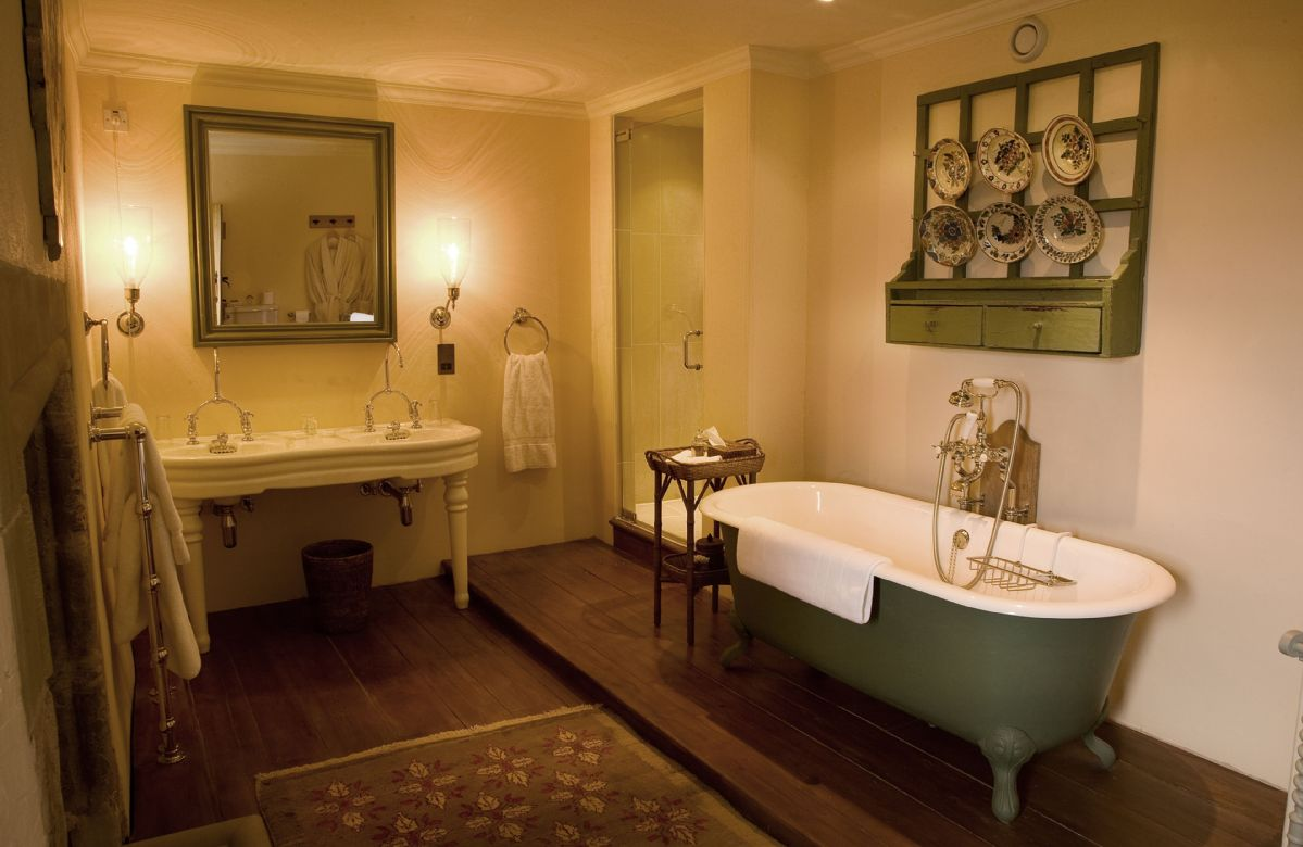 Second floor: The bathroom adjacent has a double french basin, a free standing cast iron bath and a generous walk in shower