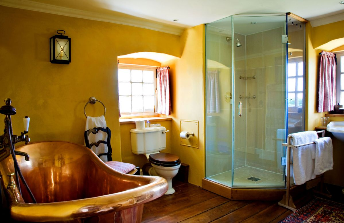 Third floor: The Erskine Suite bathroom features a fully-restored French antique copper bath and separate walk in shower.
