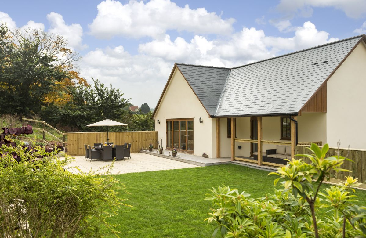 There is a fully enclosed rear garden with large patio area with space for eight to dine outside