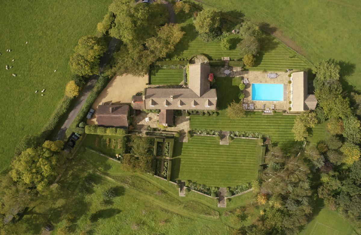 Aston Hill House sits in 15 acres of countryside and features a swimming pool with pool house and a grass tennis court