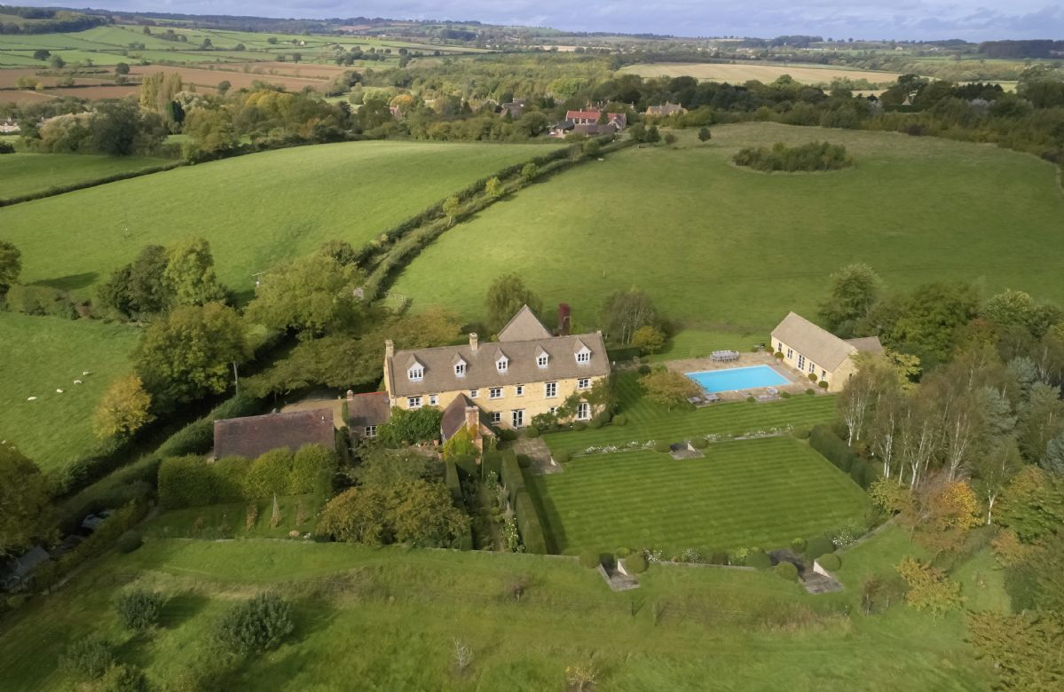 Aston Hill House features an outdoor pool and grass tennis court