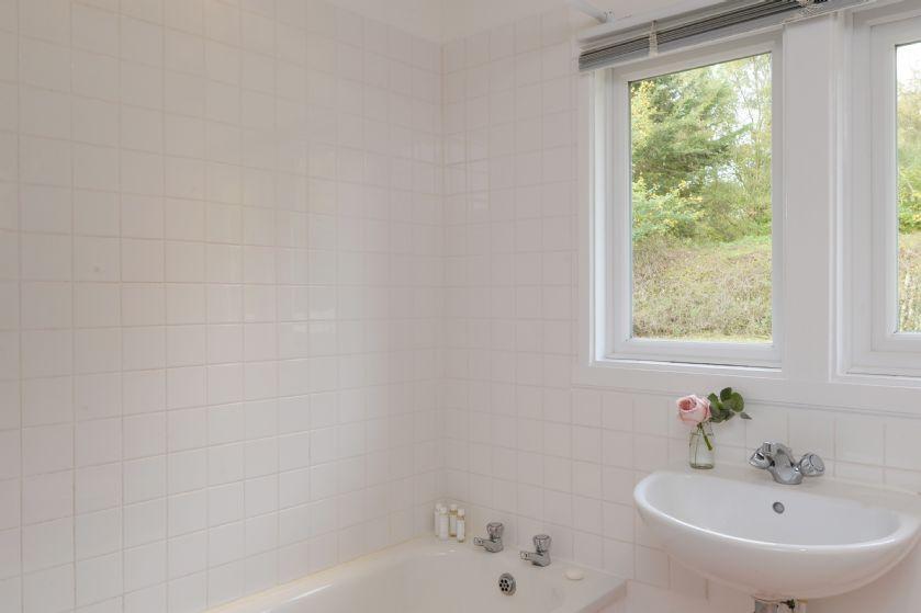 Ground floor: Family bathroom with bath and over-head shower
