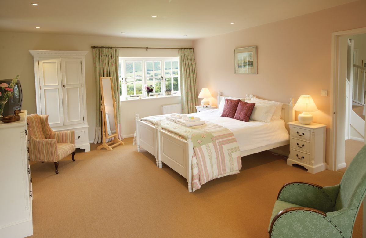 First floor: Master bedroom with a 6' zip and link bed which can convert to two 3' single beds on request