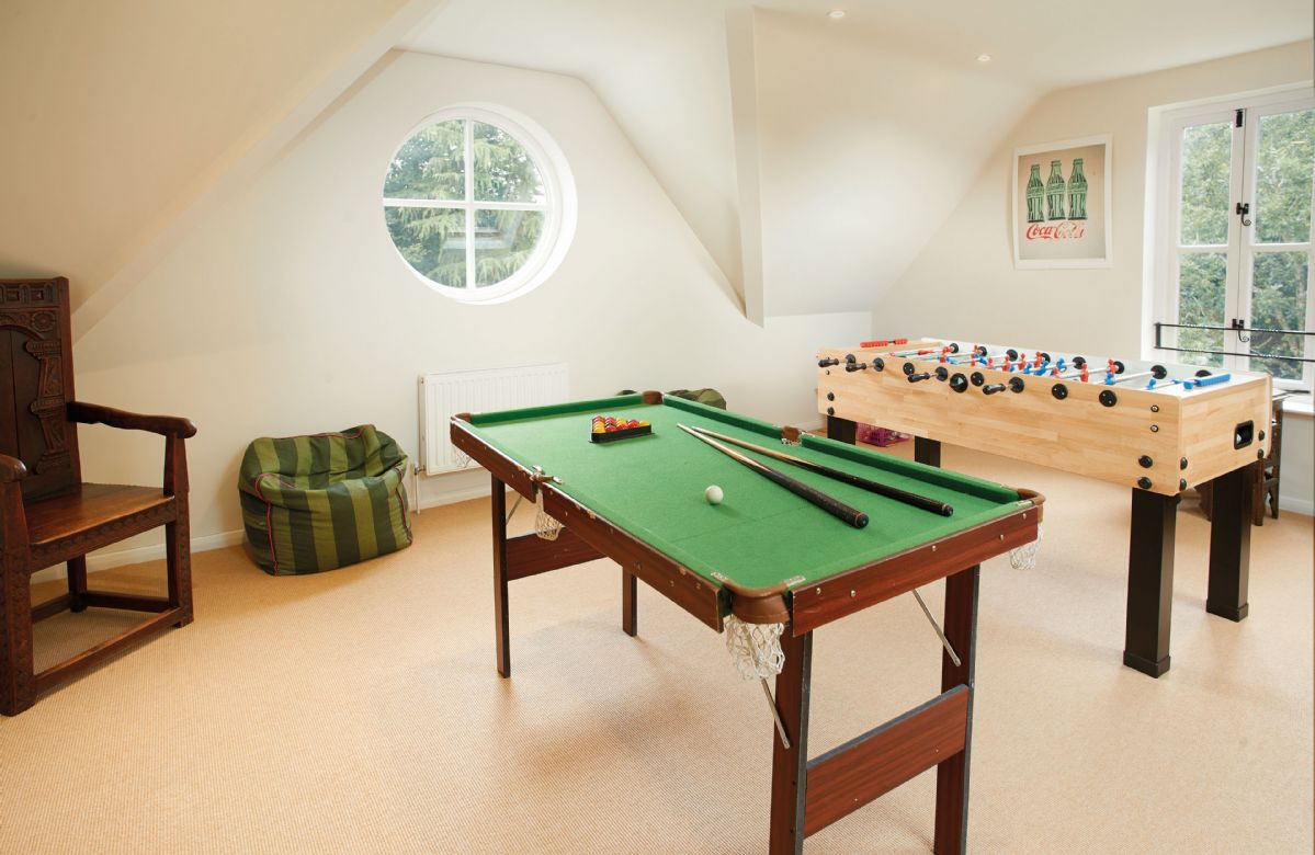 First floor:  Games room with table football and pool table