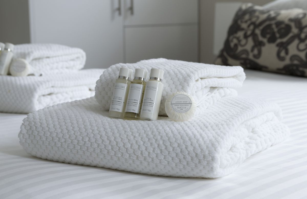 Complimentary toiletries from The White Company are provided