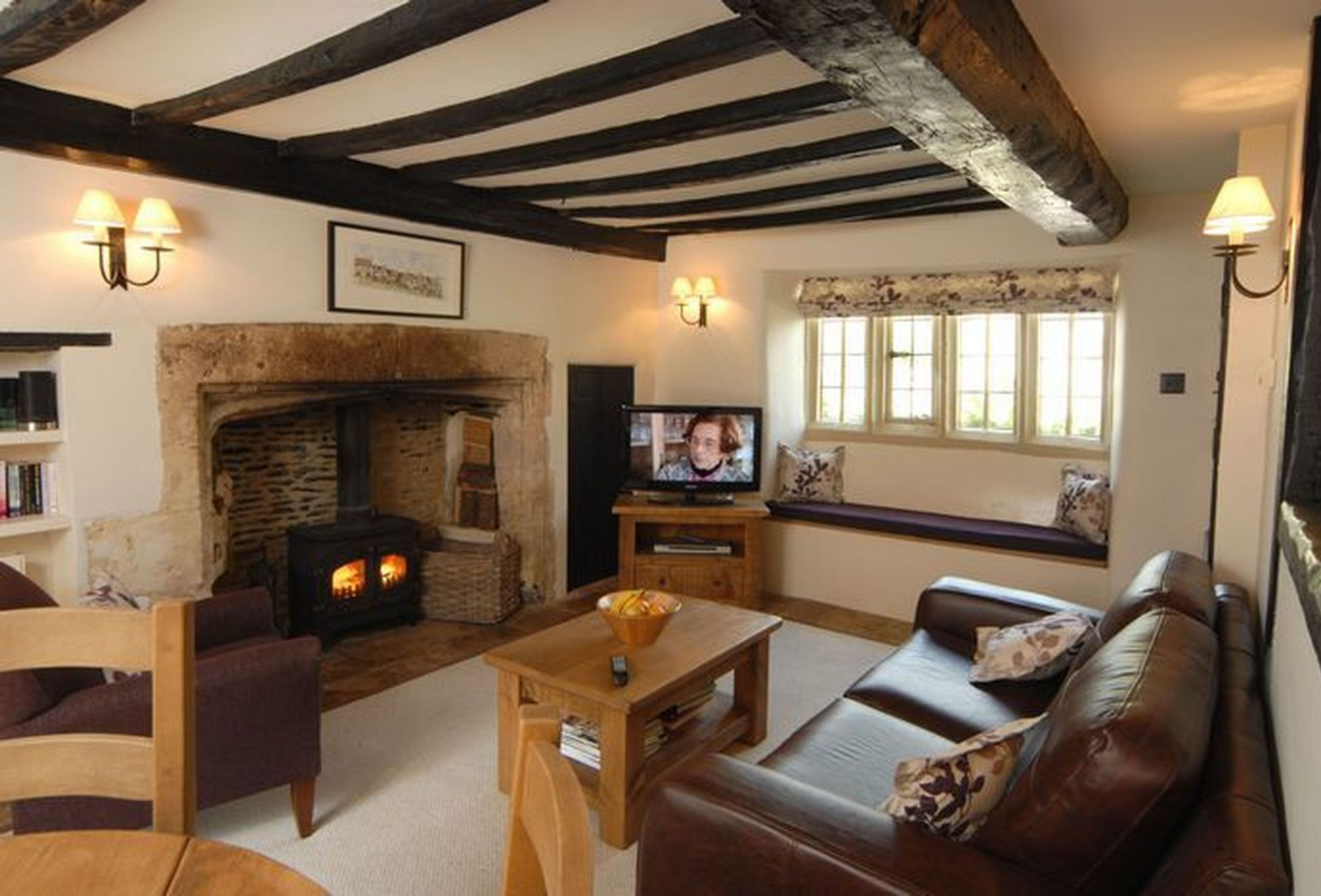 A view of the Sitting Room showing the stone fireplace