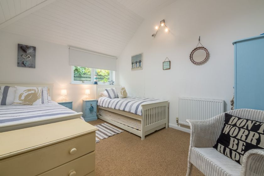 Ground floor: Up a step from the kitchen is a twin bedroom with 3' single beds