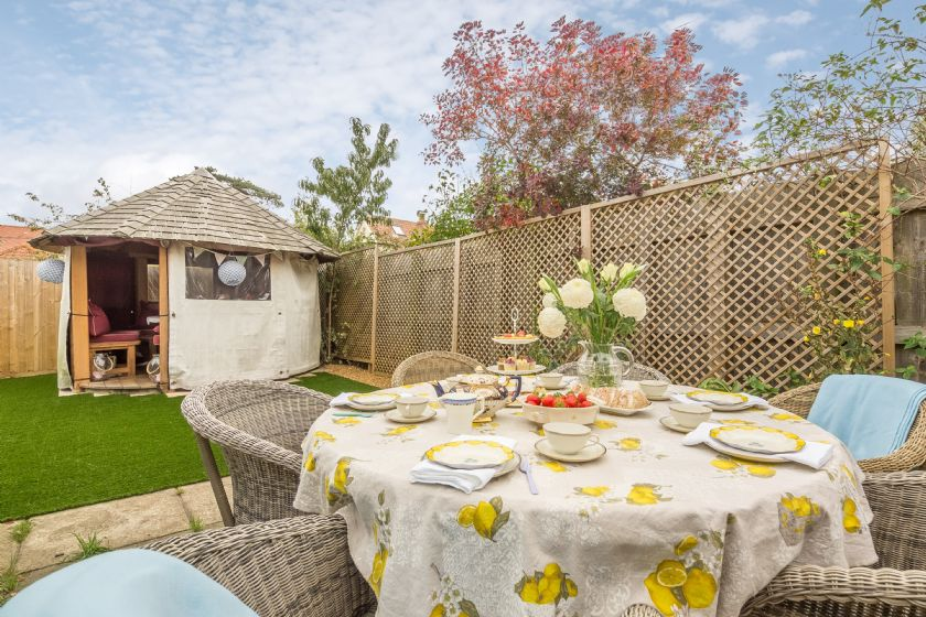 Danes House has a rear garden with paved area and garden furniture seating four