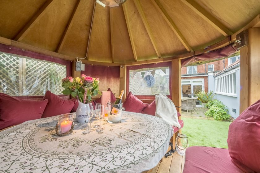 Danes House has a rear garden with paved area and garden furniture