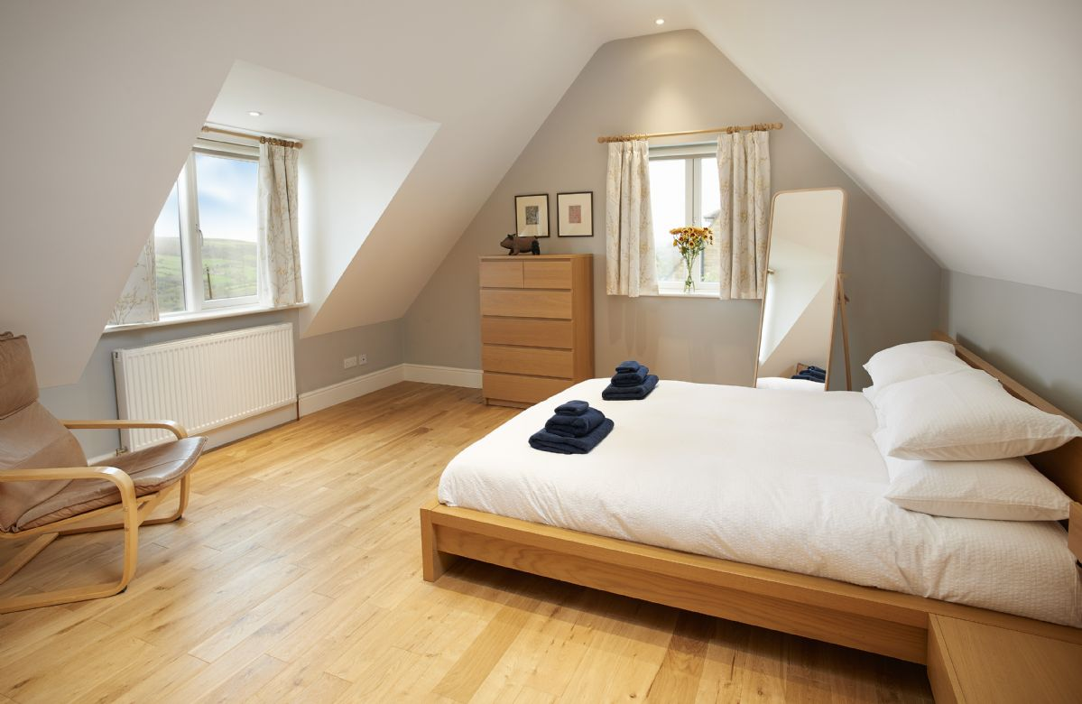 First floor: Master bedroom with king-size bed and en-suite shower room