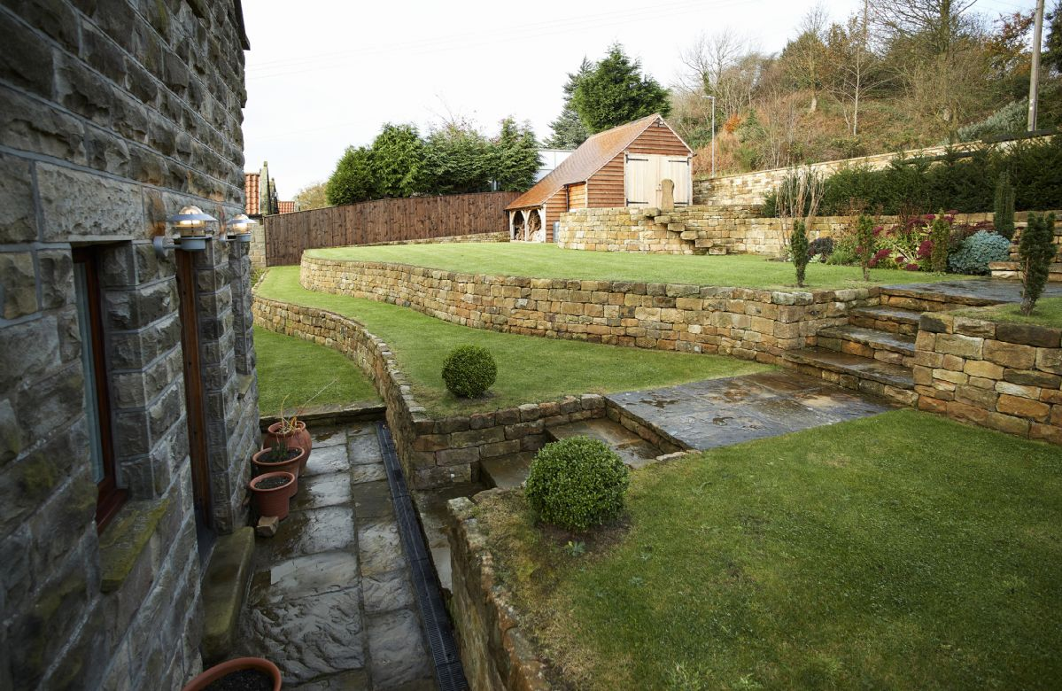 RedRoofs has beautiful terraced lawns with herbaceous borders