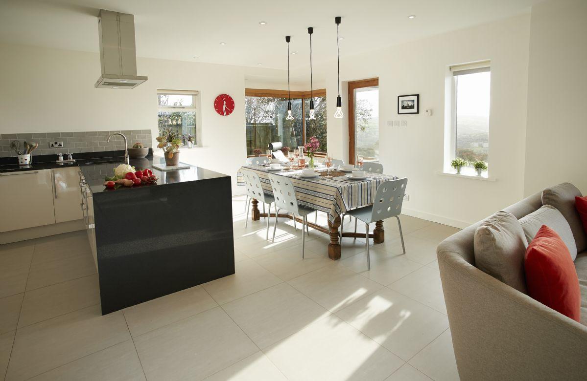Ground floor: Open plan kitchen/diner and sitting room