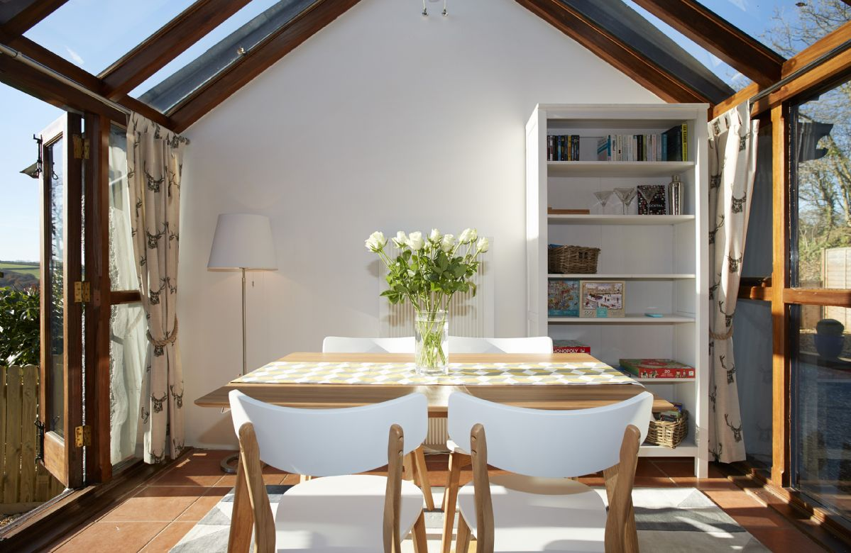 Ground floor: The vaulted conservatory dining room has far reaching countryside views