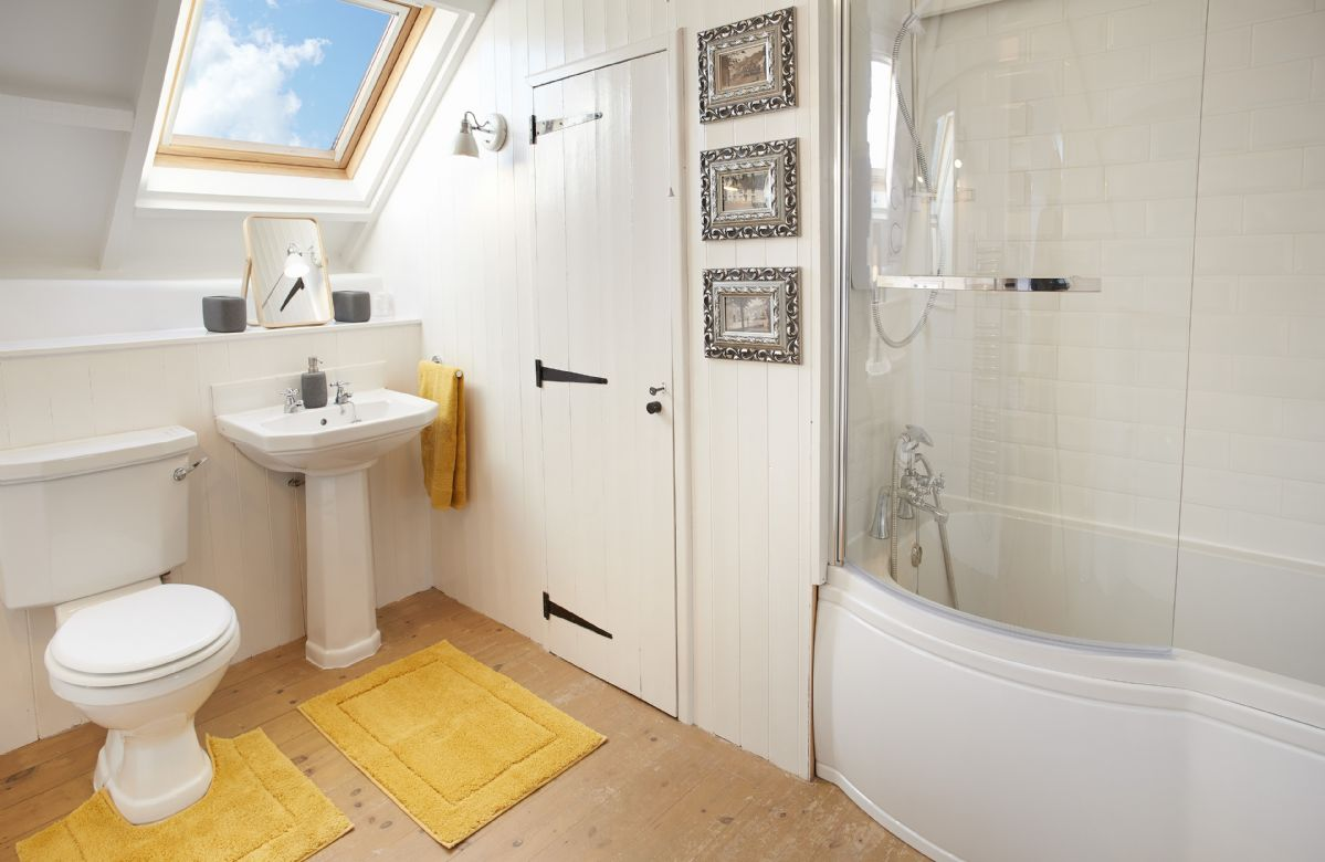 First floor: Family bathroom with bath and over head shower