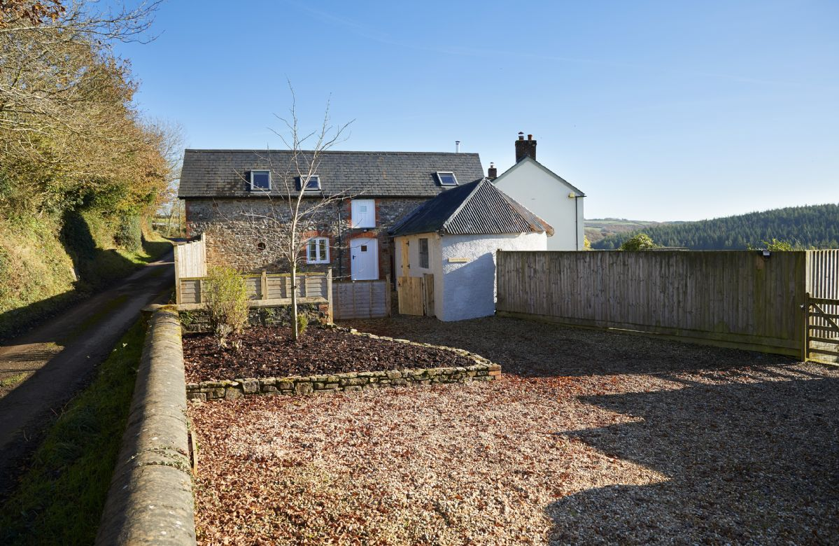 The gravel drive at Green Knowe Cottage offers plenty of space for parking