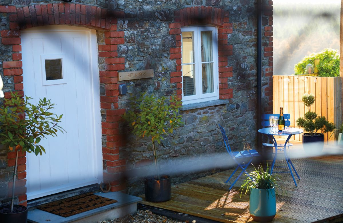 Seekings Cottage has a further decked area with bistro set