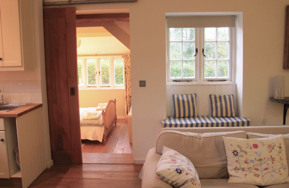 Ground floor:  View of sliding oak door to bedroom