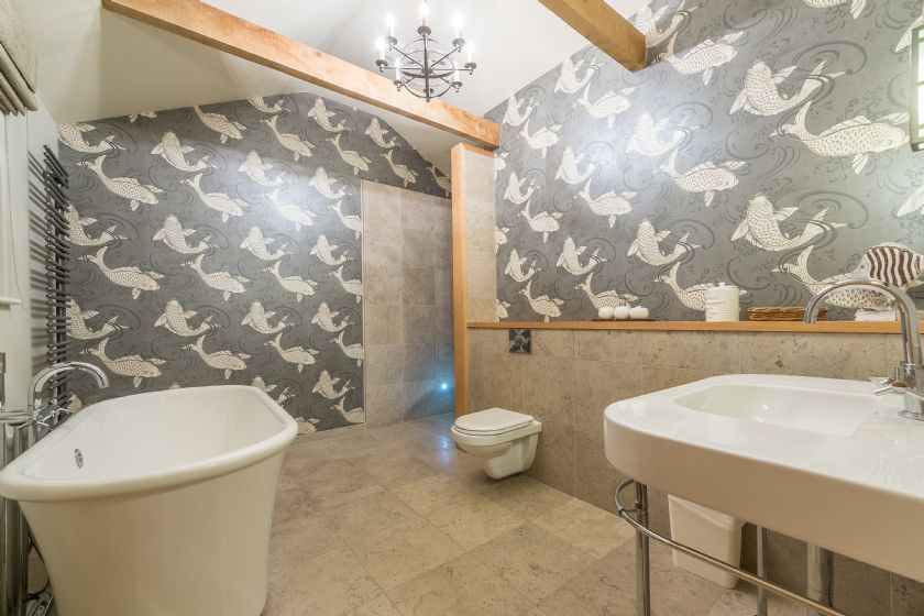 Ground floor: En-suite bathroom with free-standing bath and separate wet room shower
