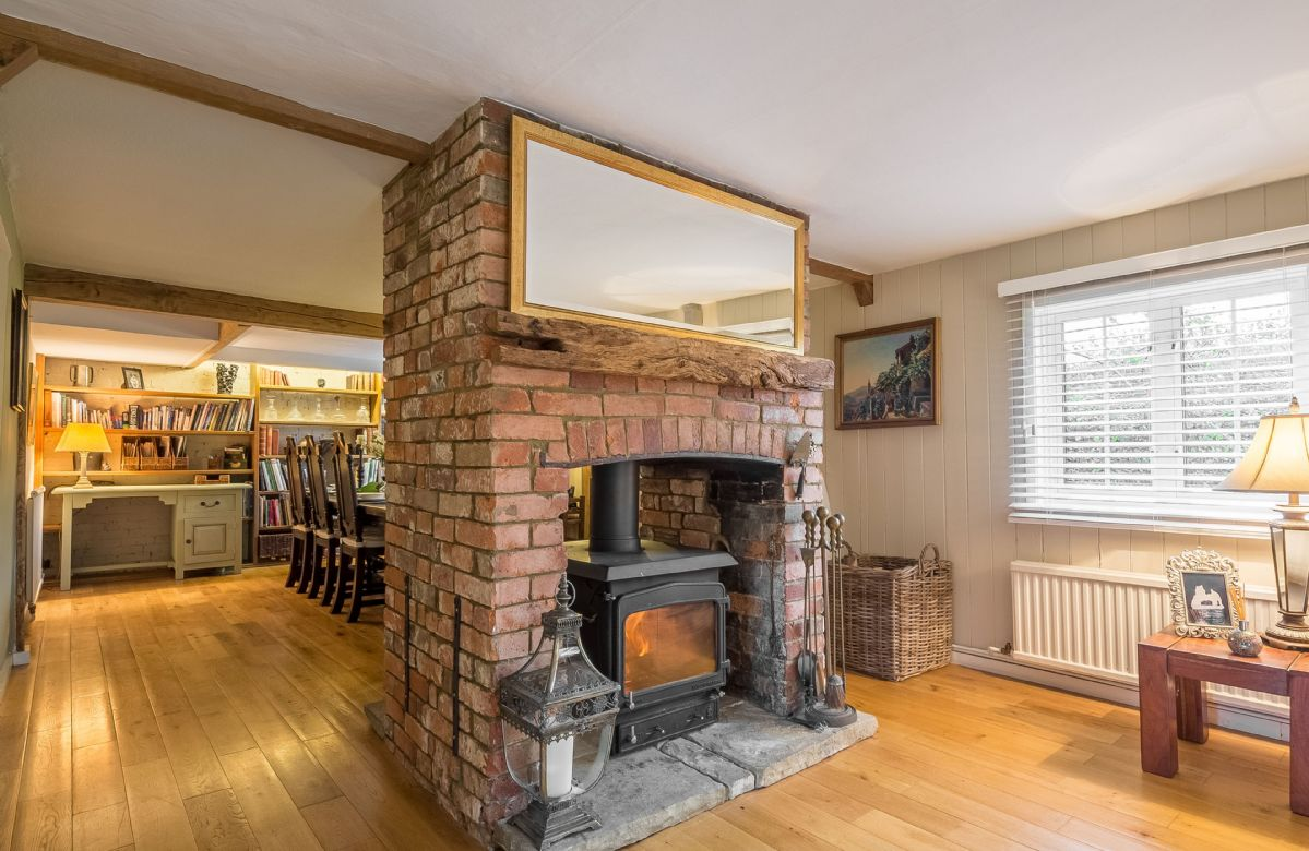 Cherry Cottage features an unusual double sided wood burning stove which keeps both the sitting area and dining area cosy