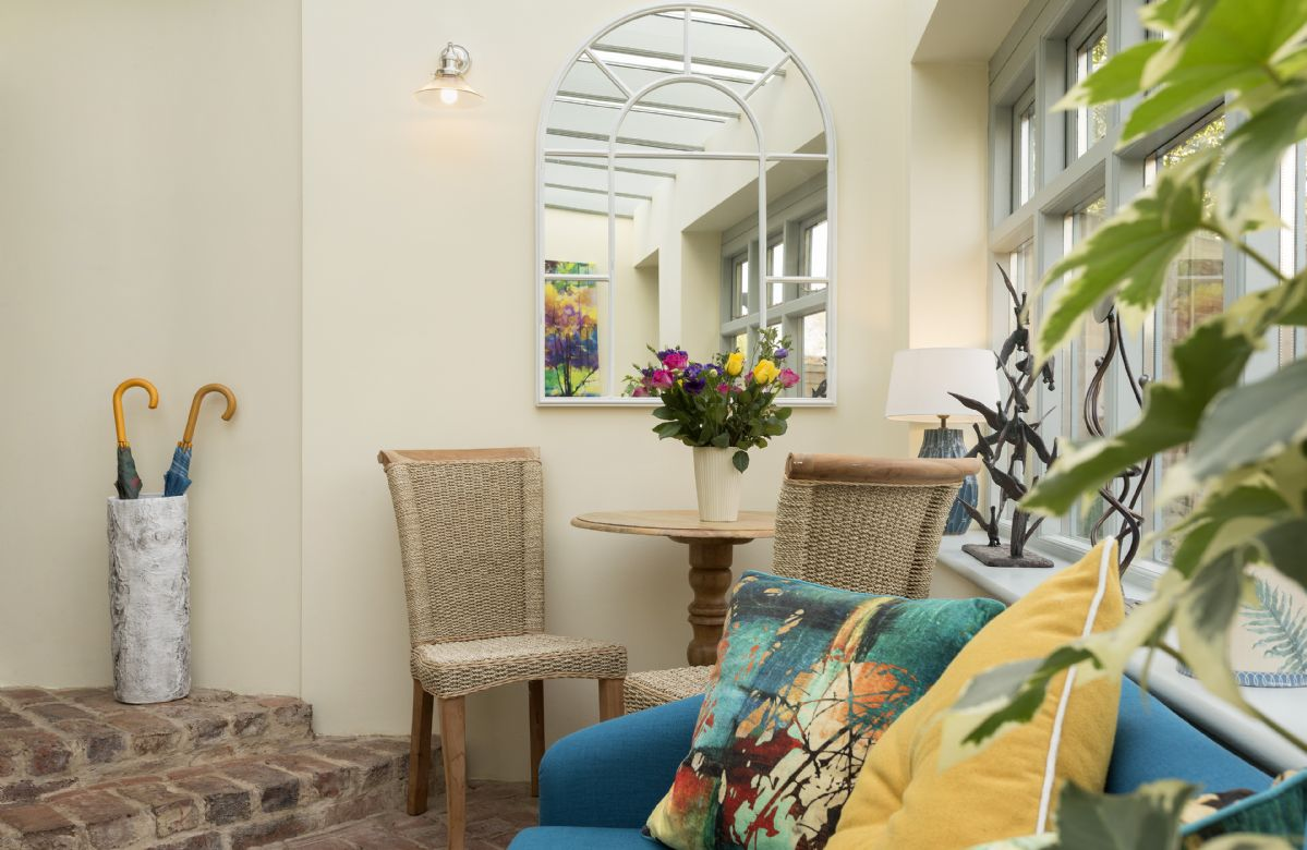 Ground floor: Sunny conservatory overlooking the pretty garden