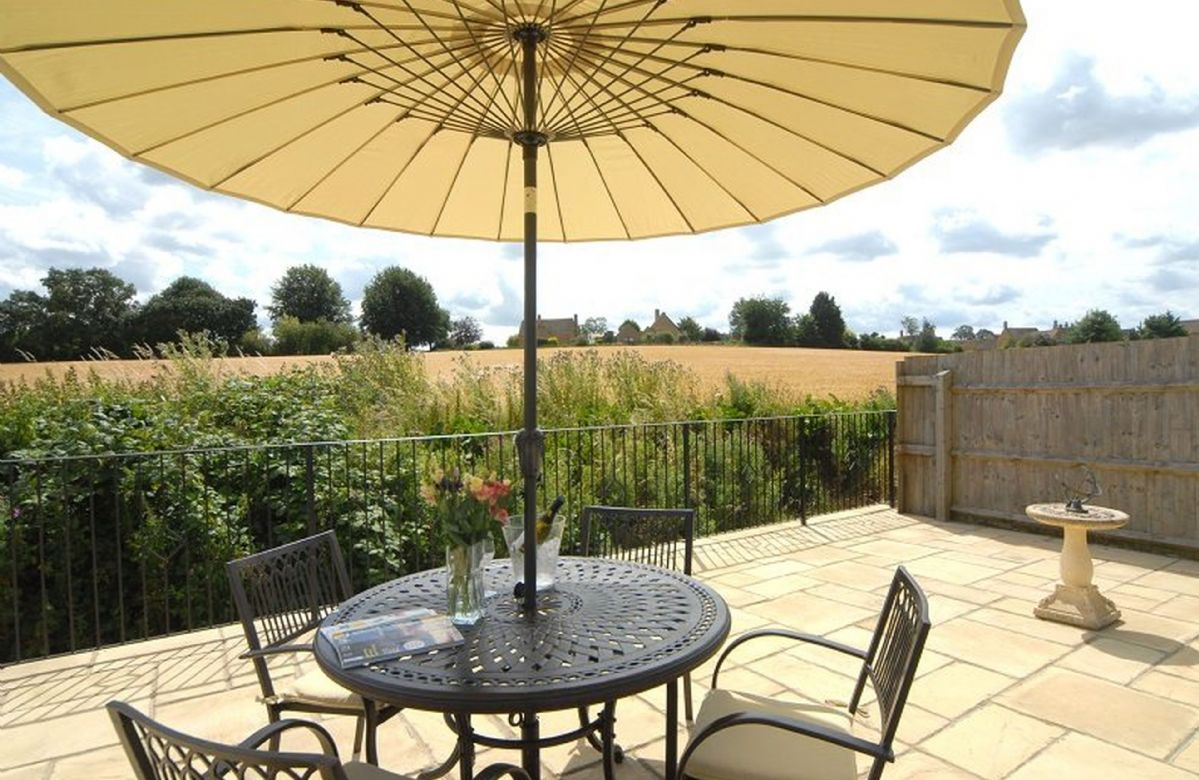 Outside: the view from the terrace across the fields