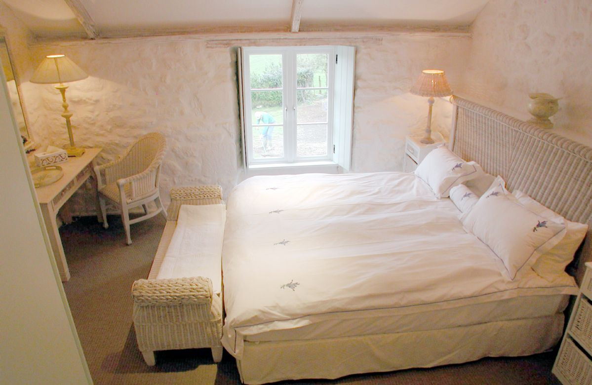 First floor: Double bedroom with 6' super-king bed and bathroom opposite with bath and shower over