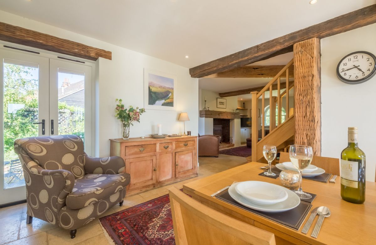 Ground floor: Dining area with French doors to the garden