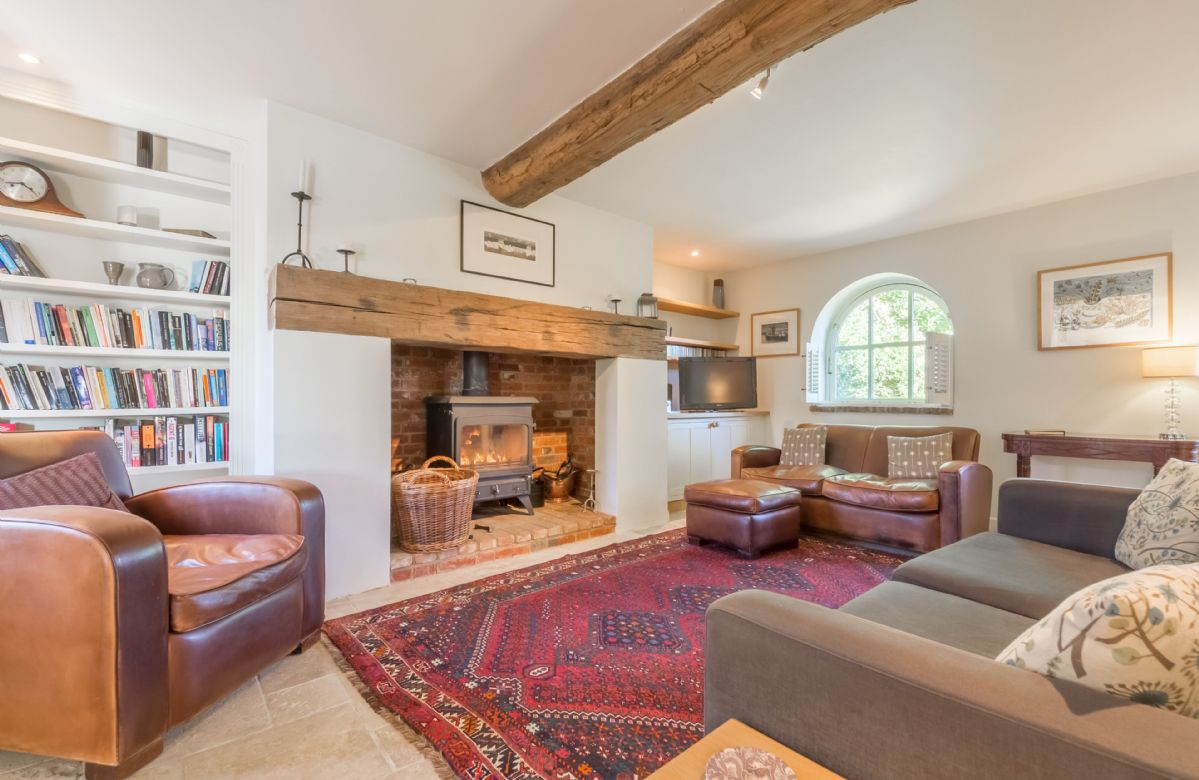 Sitting room with feature fireplace and wood burning stove