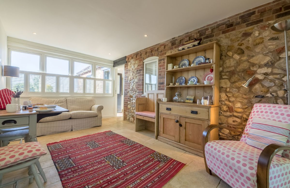 Ground floor: Dual aspect garden room with French doors leading to the front terrace