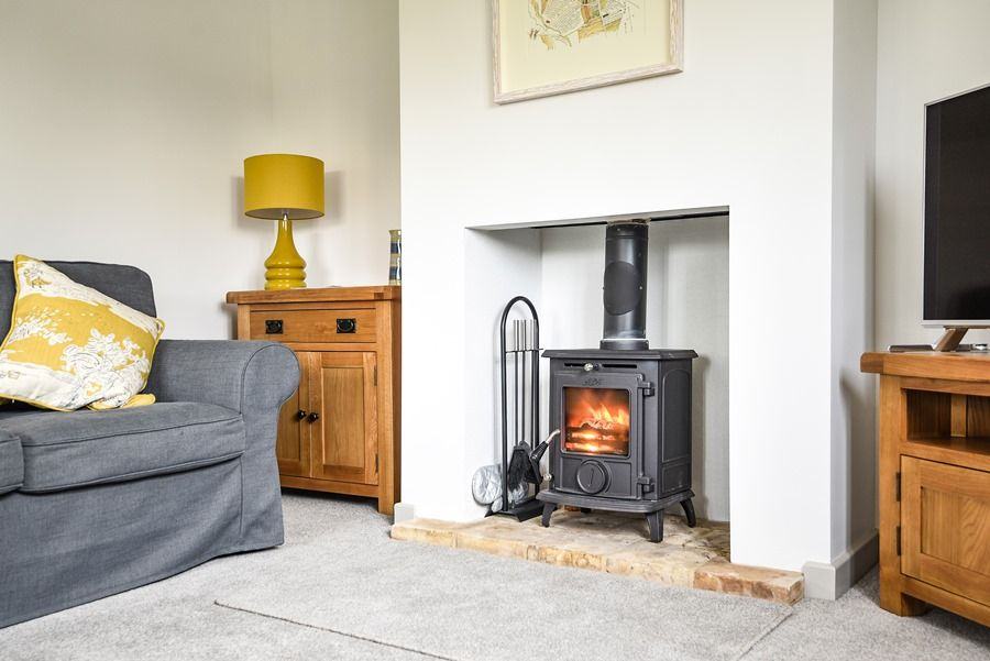 Violet's Cottage | Sitting room wood burner