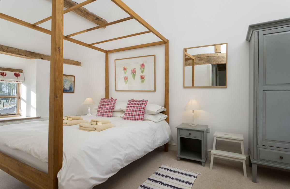 First floor: Double bedroom with 5' four-poster bed